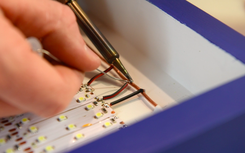 Soldering the LEDs to the Bus Wires