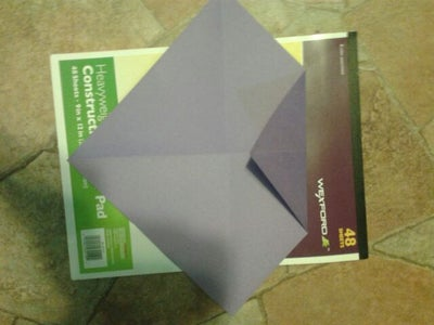 Fold the Top Point and Fold It Till It Looks Like a Triangle