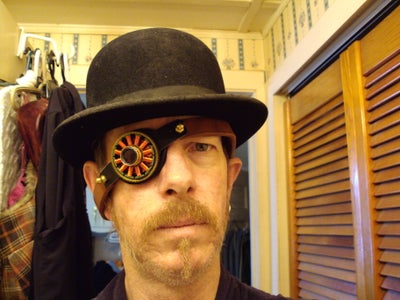 Uni-ocular Enhancement Device