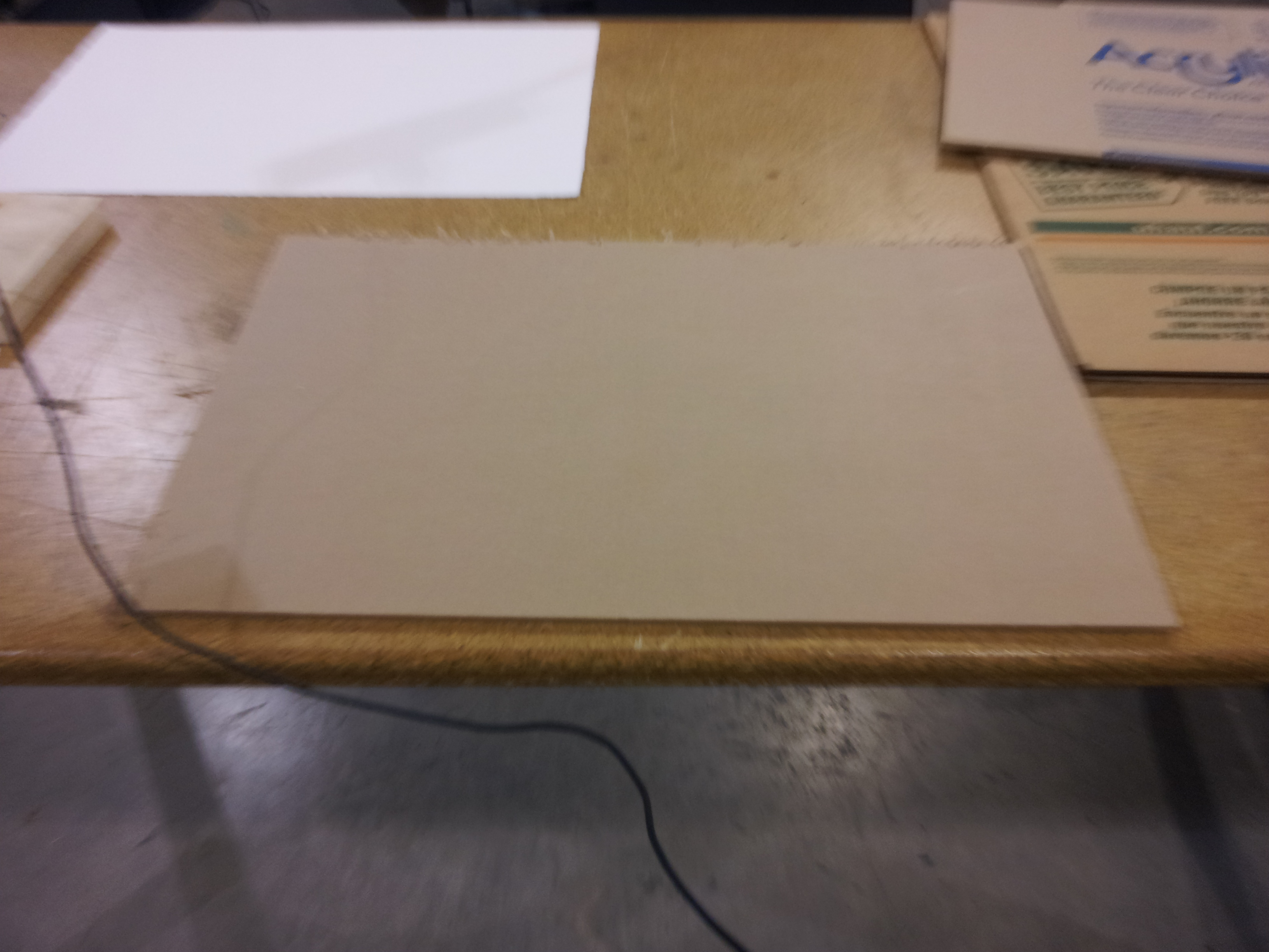 Picture of Using the Cardboard to Make a Test Cut, and Cutting the Acrylic
