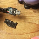 Reattach a USB charging cable housing cover with sugru