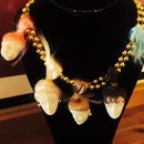 Shrunken Dollhead Necklace