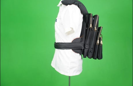A Hip Strap Is Attached and the Bag 'hugs' the Users Back, Evenly Distributing Pressure Exerted.