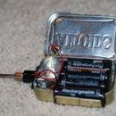 Make a battery powered soldering iron! In an Altoids tin?