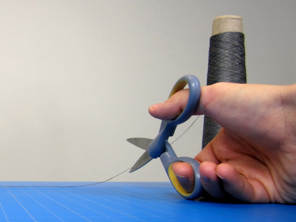 Picture of Cut Thread, Thread the Needle, and Knot the End of the Thread