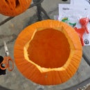 Carving my pumpkin with a design found on Google