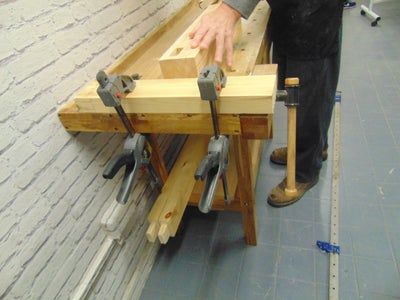 First, We Made the Base..Using a Saw and Chisel, We Created a Tenon and Mortise Joint to Connect the Legs to the Base of the Table..