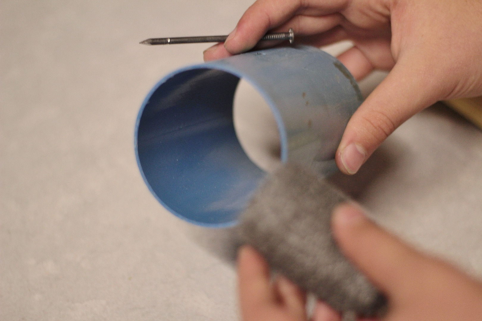 Picture of Take Out the Nail, Insert the Steel Wool, and Replace the Nail