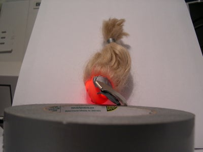 Stick Led Into Barbie's Head