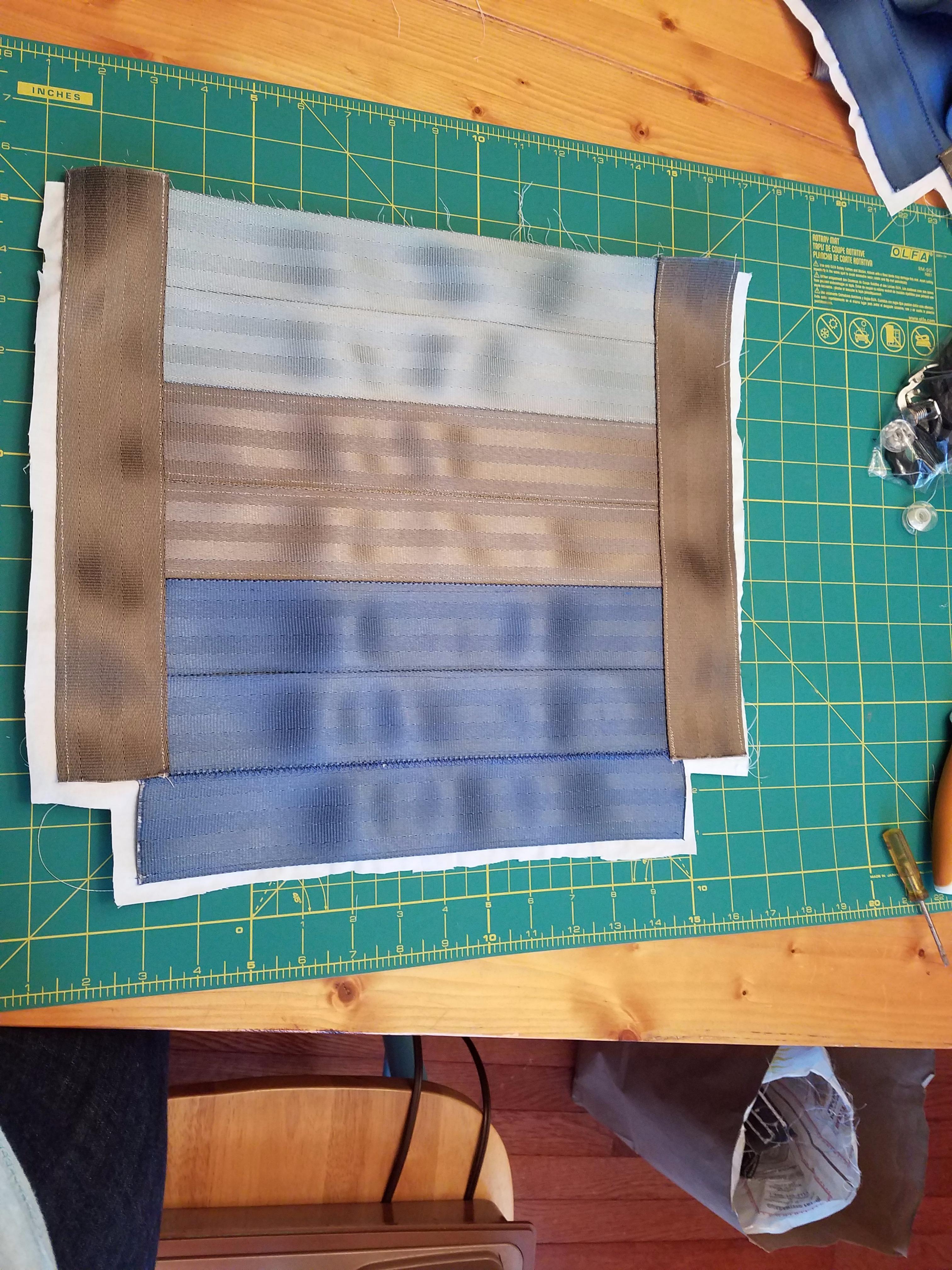 Picture of Trim Fabric Around Seatbelt Material
