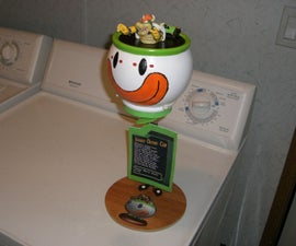 Bowser's Koopa Clown Car model with sound effects, lights, & propeller. Made from old cookie jar.