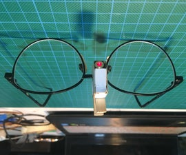 Spectacle-mounted Laser Pointer for Persons With Locomotor Disabilities