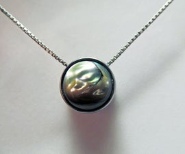 A Steel and Sea Shell Pendant
