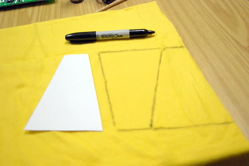 Picture of Utilize the Template to Trace It Over the Yellow Felt Twice and Cutting Them Out.