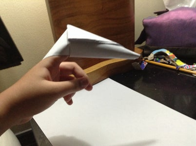 And Lastly, All You Have to Do Is Put the Top Point and Fold It Inside the Flap