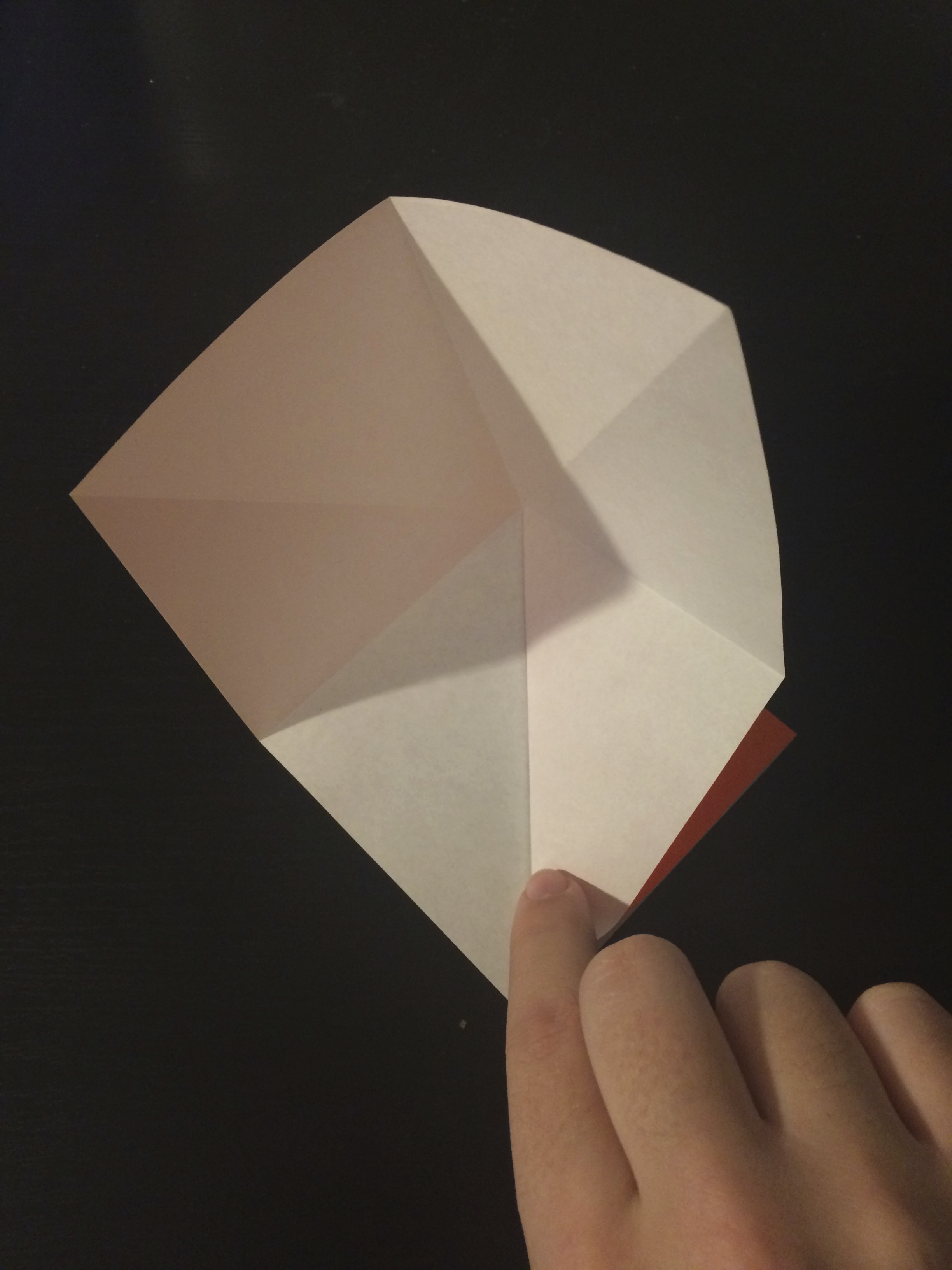 Picture of Use the Creases to Fold Inward Into a Smaller Square.