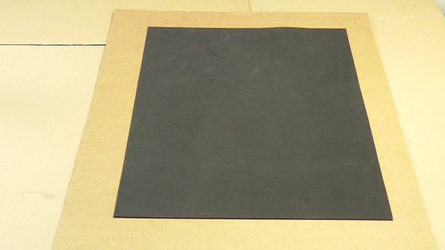 Picture of A Piece of Cardboard and Black EVA or Fomi