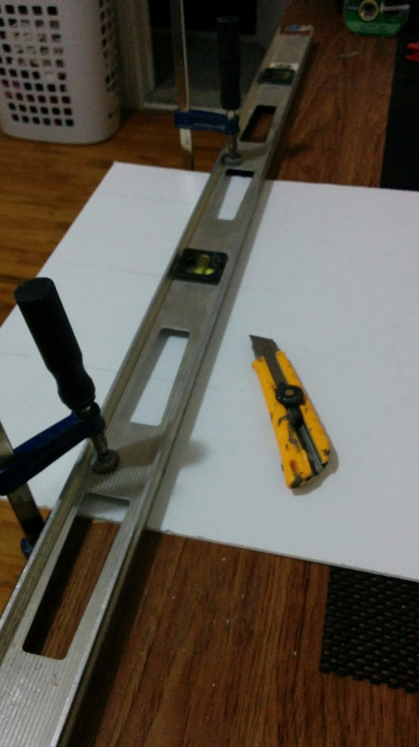 Picture of Cutting the Plexiglass and Backing Material