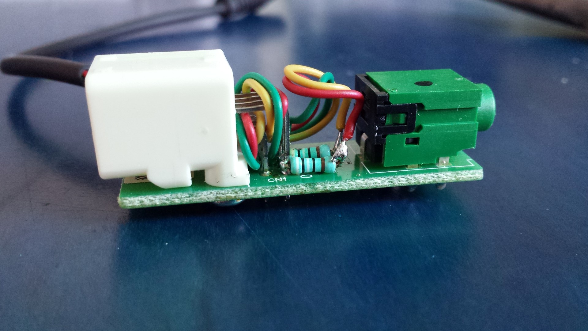 Picture of Solder the Resistors and Bring Out Another Audio in Port