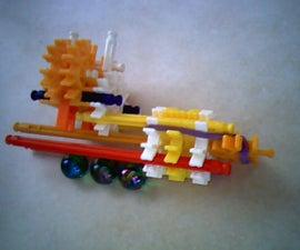 Knex auto-loading marble gun