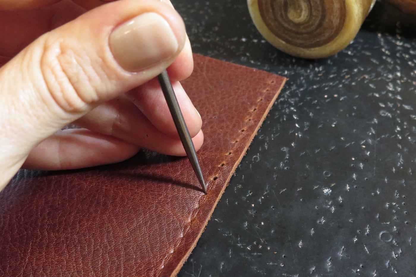 Punching Sewing Holes With an Awl