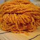 Turmeric dyed yarn