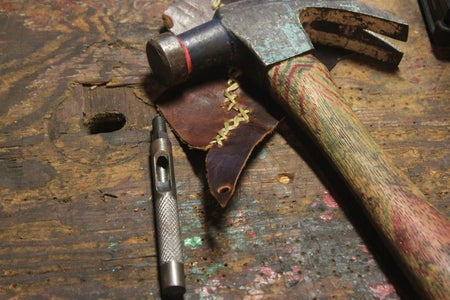 Punch Holes for Buttons... Set Snaps... Add Leather Strips for Knives