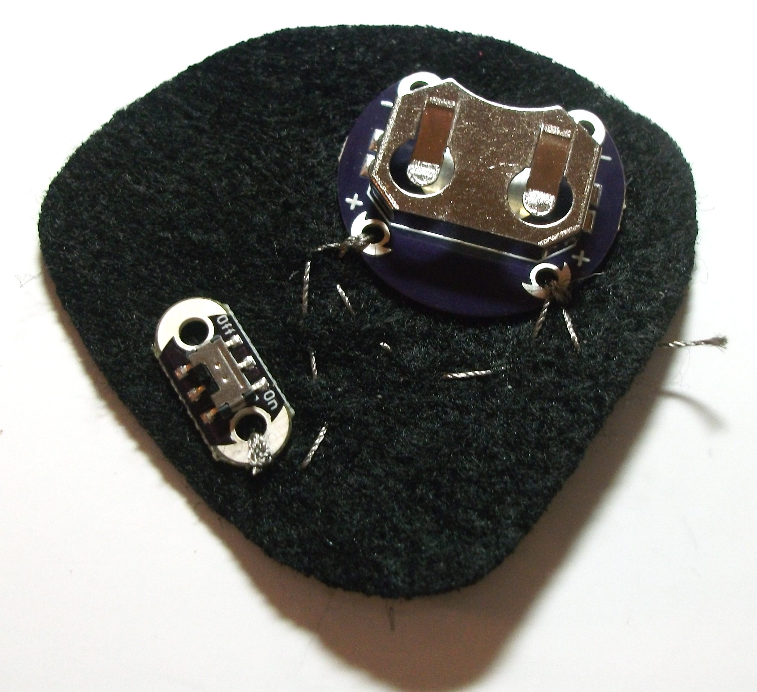 Picture of Finishing the Circuit Between the LED and Battery Layers.