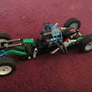bare body lego car with rotating engine