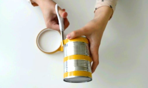 Stick a Decorative Paper on the Can.