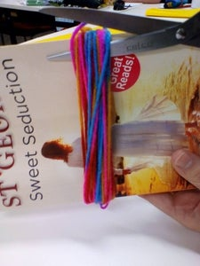 Then Cut the String From the Open Side of the Book