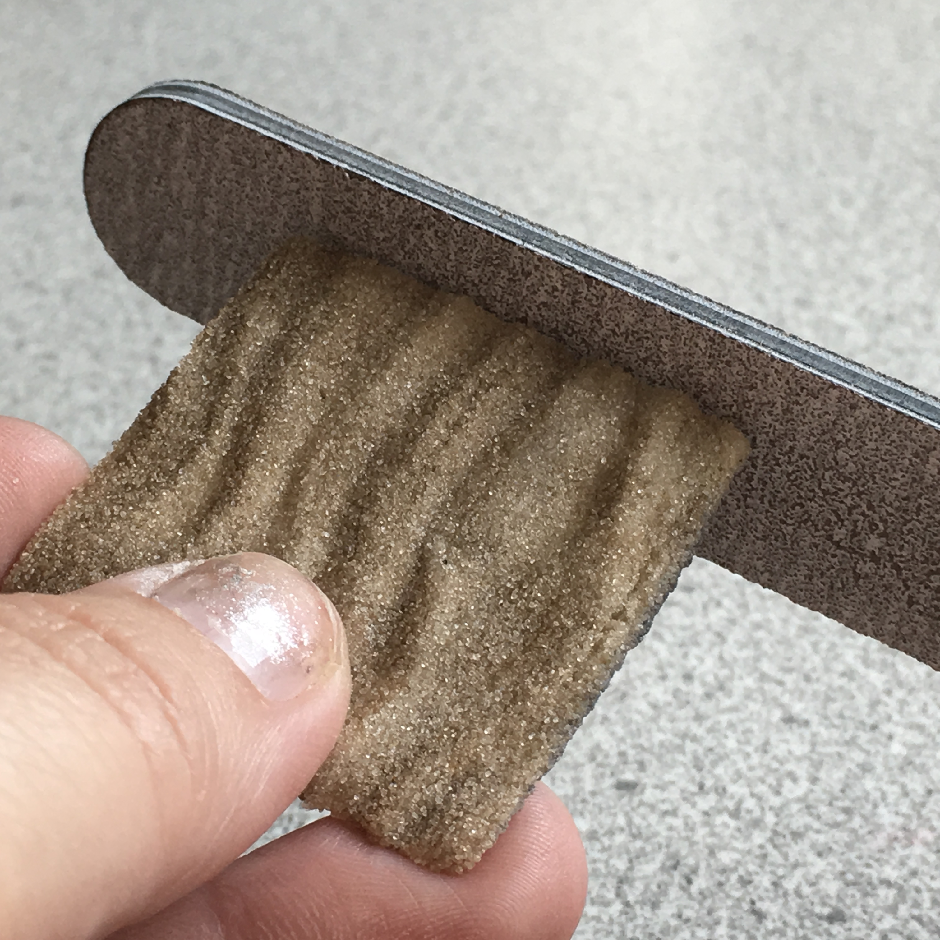 Picture of Sanding Rough Edges