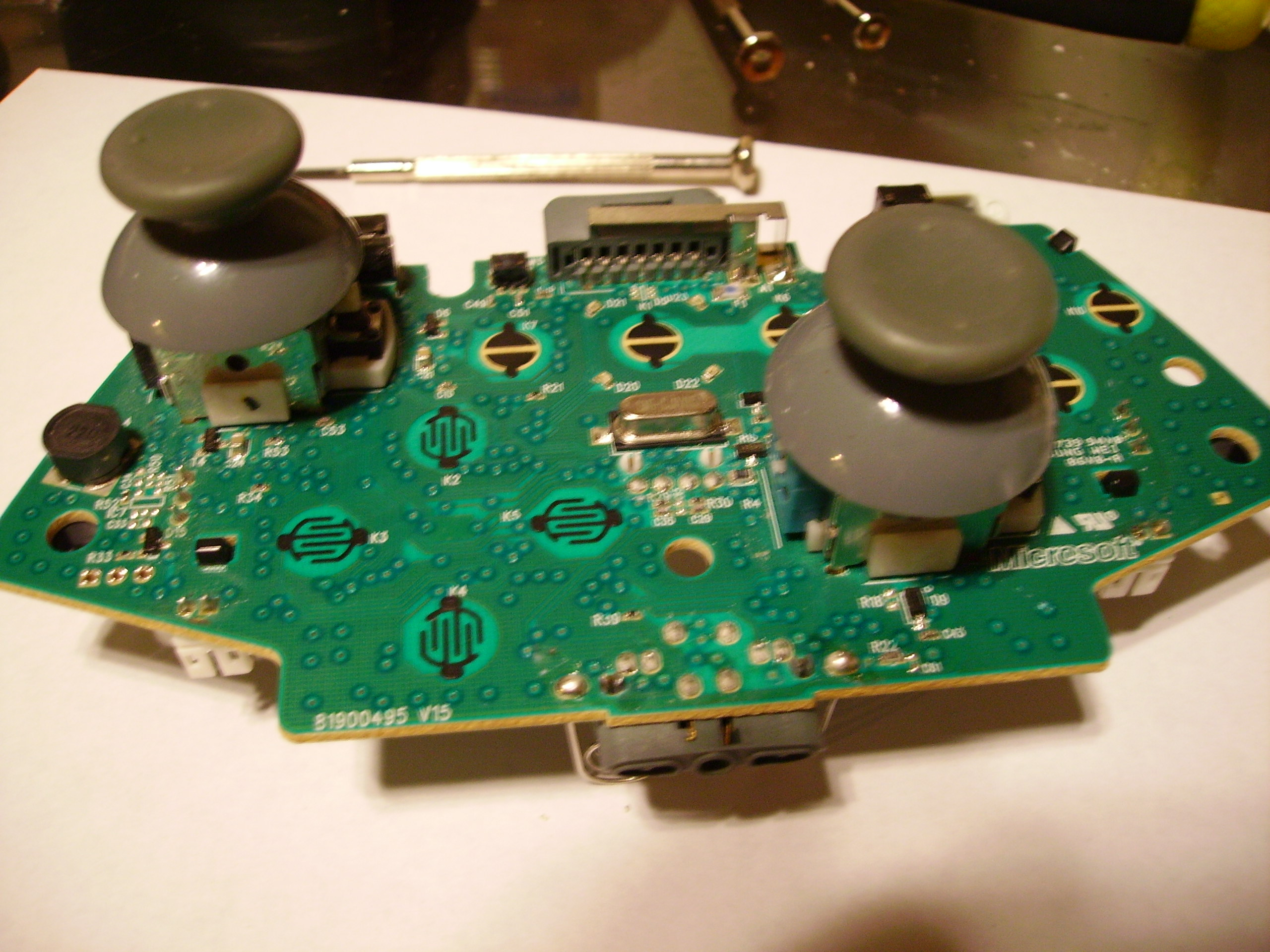 Picture of Solder the New Analog Joystick to the Board.
