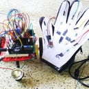 Paper,pencil,a touchsensing glove and an wireless robot!!