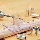 Improving an otherwise low precision woodworking drill jig