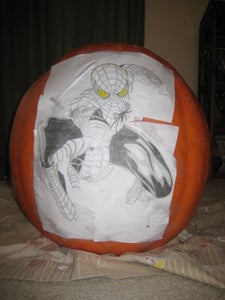 Step 2: Tape the Pattern to the Pumpkin