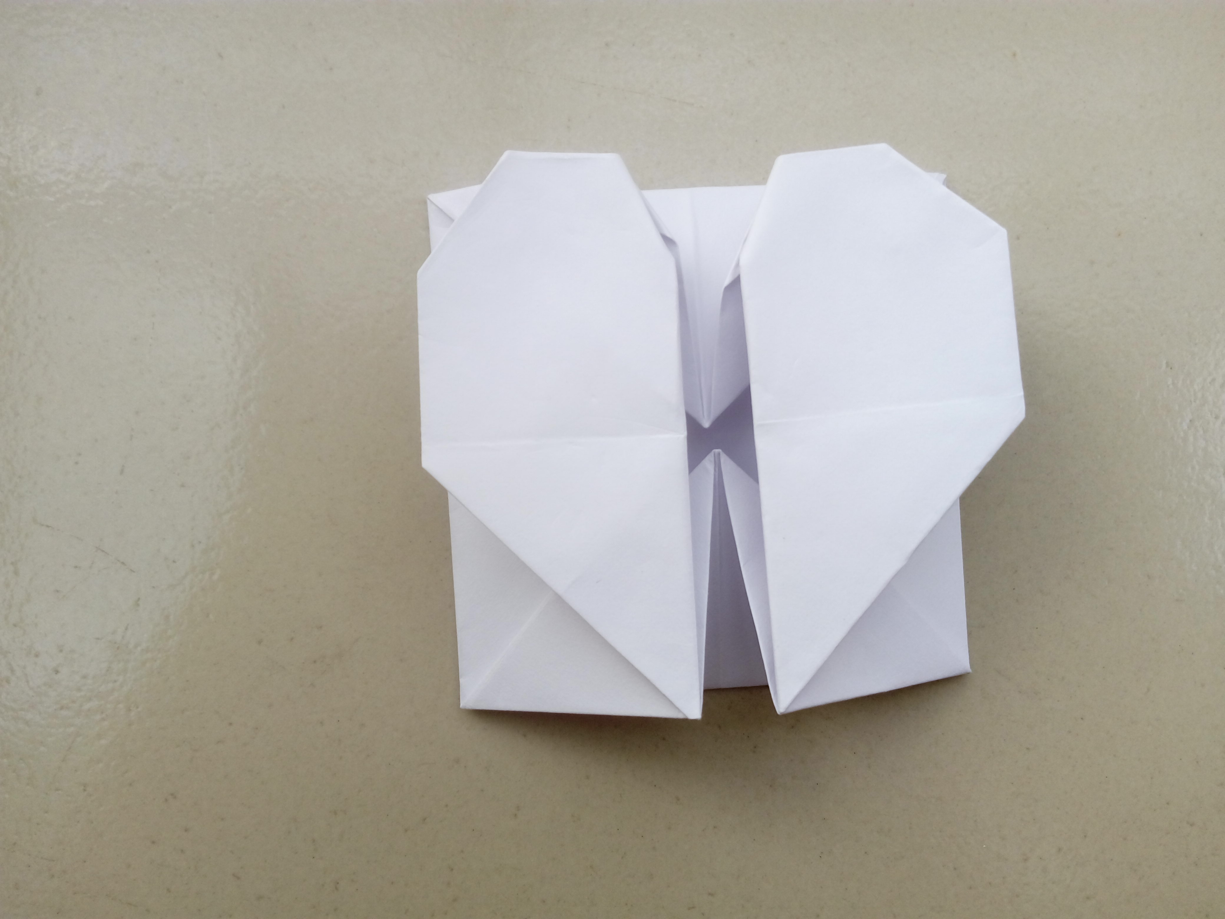 Picture of Diagonally Fold Back Both Bottom Corners to Make the Bottom of the Heart.