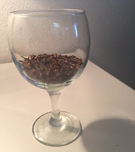 Fill the Wine Glass Quarter Way With Clove Seeds.