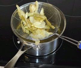 Frying Potato Skins And Bananas For Snacks