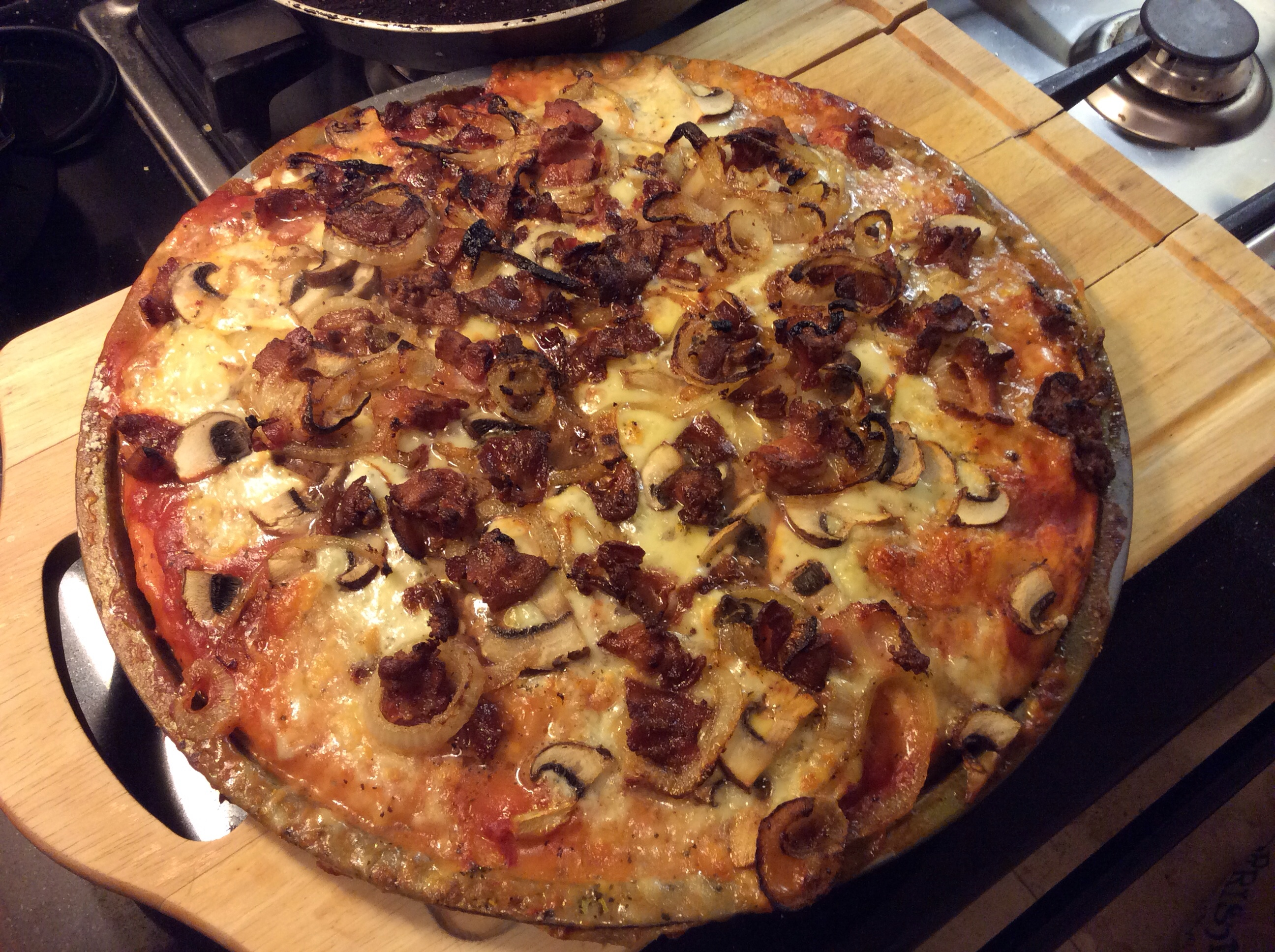 Picture of Home Made Pizza With Bacon, Mushroom and Onion