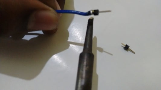 With the Help of Helping Hands Solder the Pin to Wire