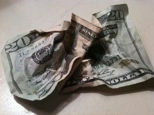 How do I make a crumpled dollar bill be smooth like new again?