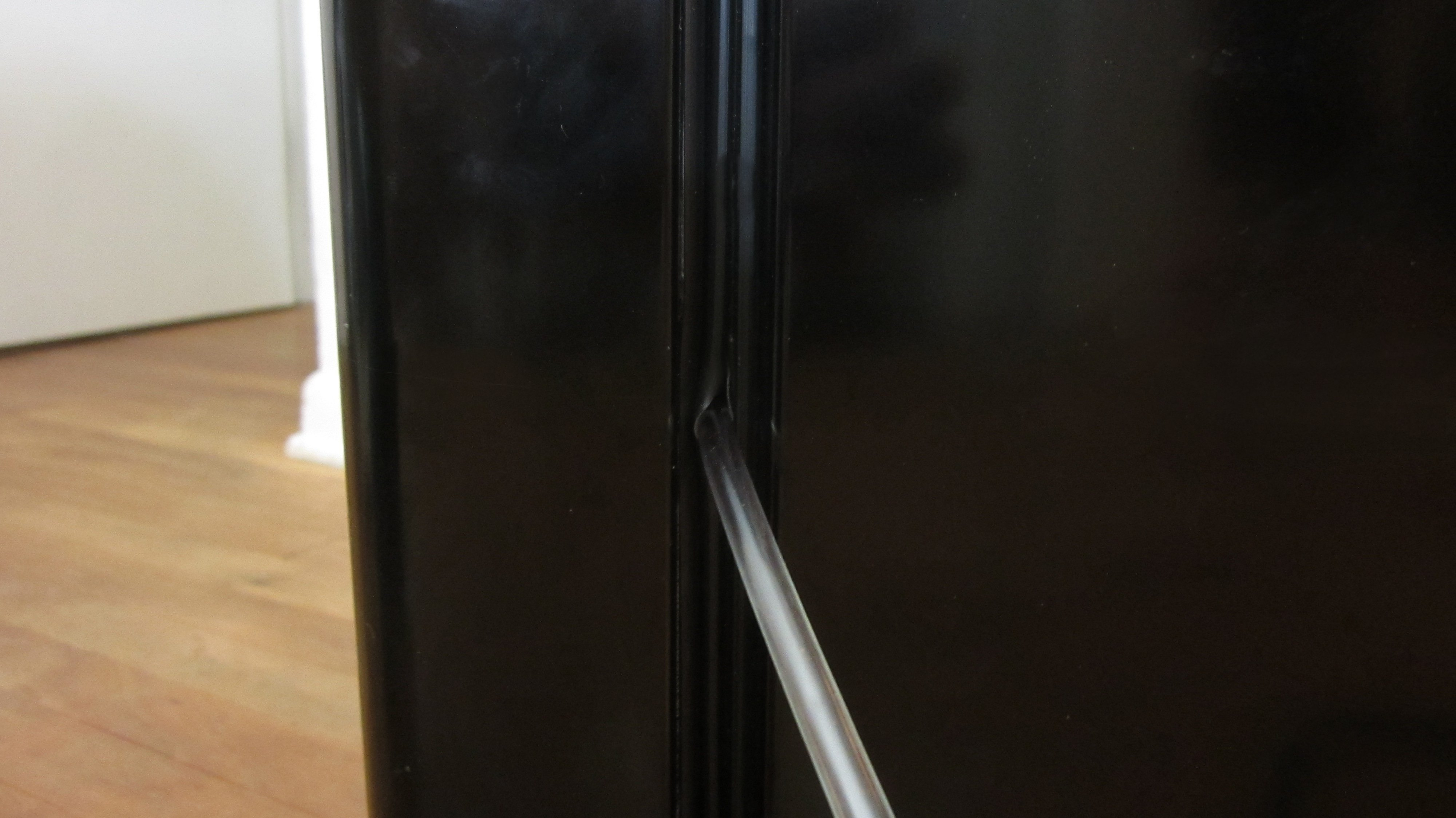 Picture of Cut Two Holes in the Side of the Refrigerator