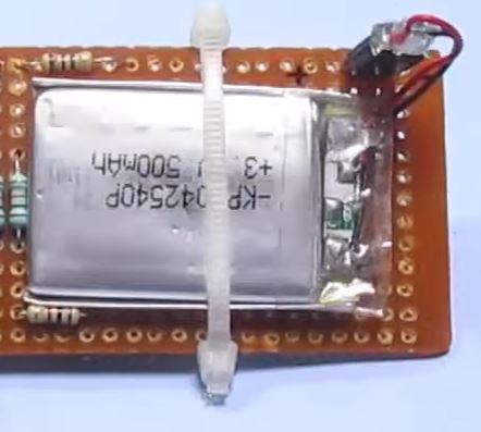 Picture of Put LCD Battery on Board and Zip Tie
