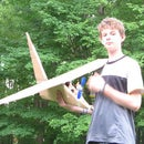 Huge cardboard airplane with propeller that is powerd by motor