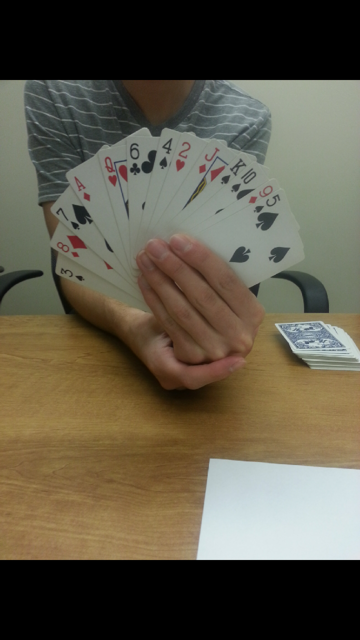 """Picture of Removing the """"Randomly"""" Arranged Cards"""