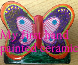 Kids Build - Hand colouring a ceramic butterfly