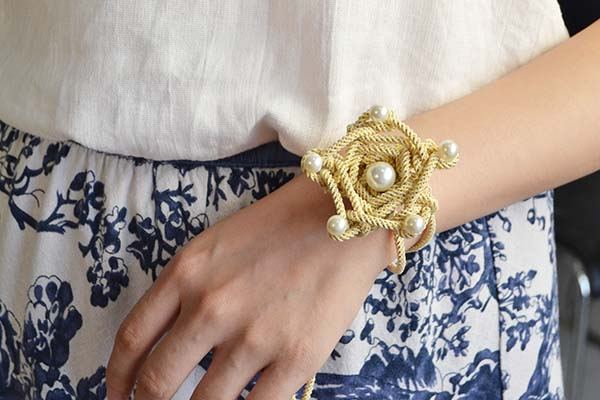 Picture of Here Is the Final Look of the Champagne Yellow Polyester Cord Star Flower Bracelet With White Pearl Decorated.