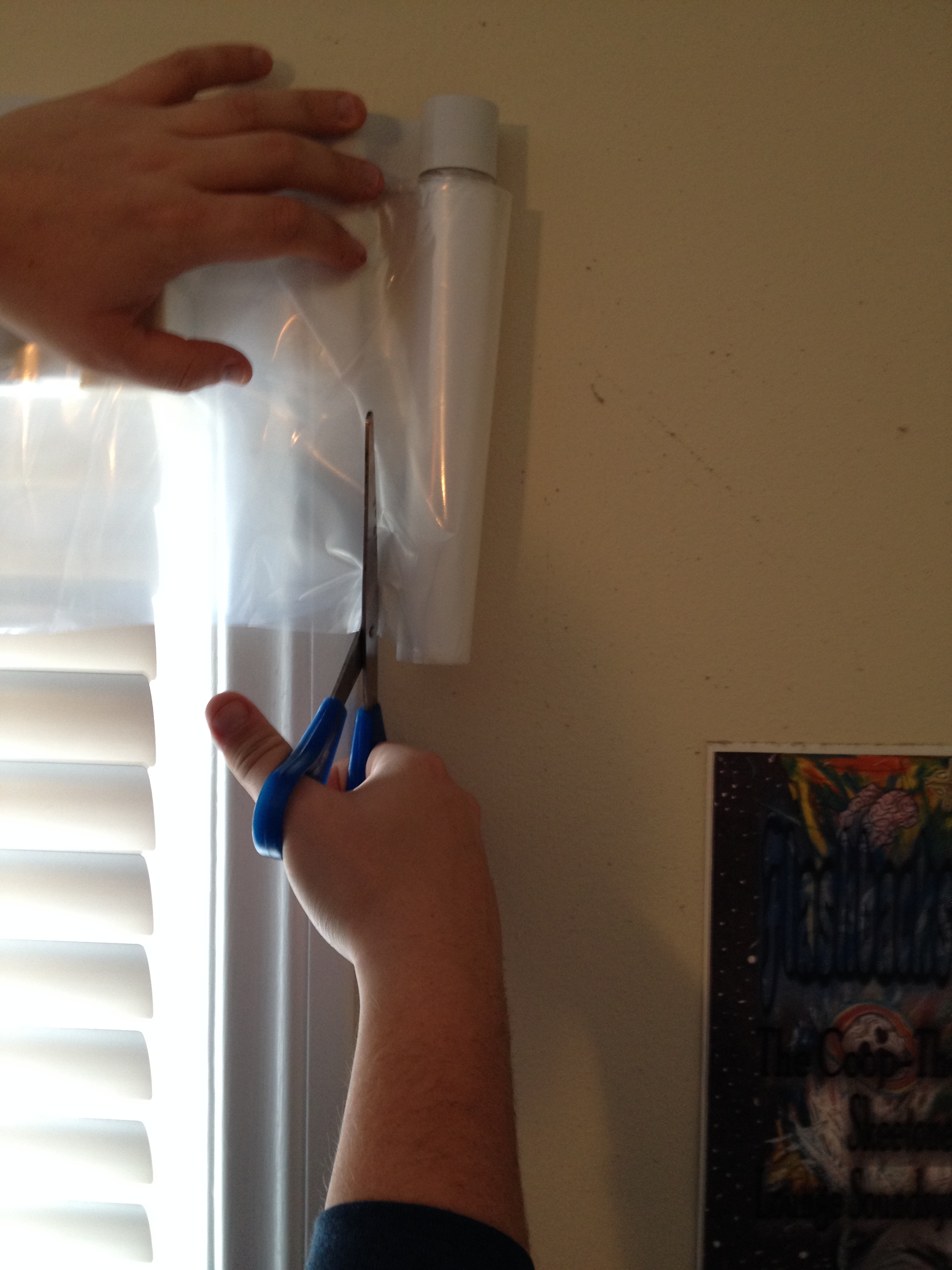 Picture of Cut a Sheet of Plastic Just a Smidge Larger Than the Window.