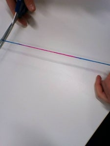 Cut 10 Cms of String From the Ball.